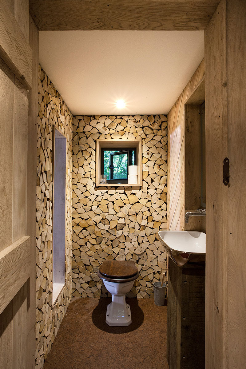 This small washroom is part of a grown-up two-storey modern treehouse.