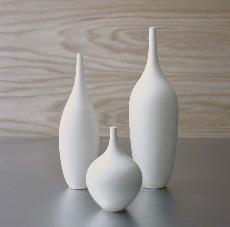Home Decor Ideas - 6 Ways To Include Ceramic In Your Interior // These super simple minimalist white ceramic vases look great both on their own and as a set.