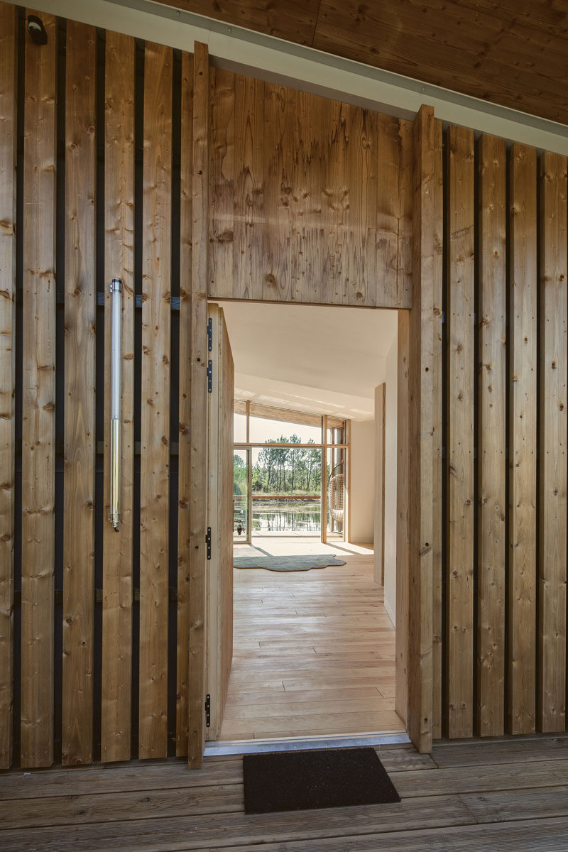 A wooden covered entrance to a villa at an eco-resort in France.