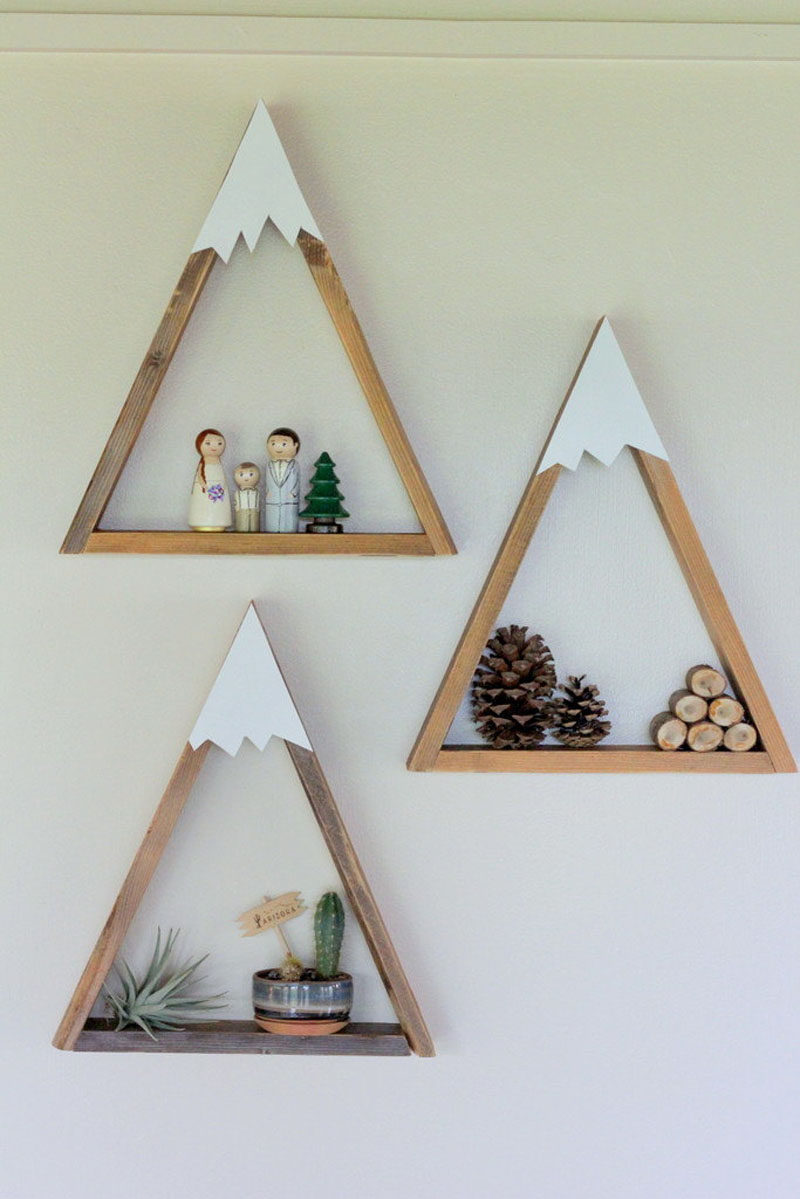 15 Decor Ideas For Creating A Woodland Nursery Design // These mountain shelves are a fun way to put a twist on a regular triangle shelf and create the perfect modern woodland shelving solution.