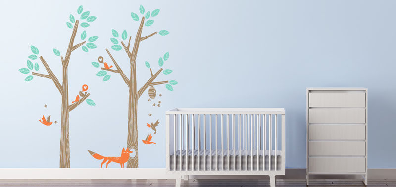 15 Decor Ideas For Creating A Woodland Nursery Design // Create a woodland setting using wall decals with trees, birds, and animals.