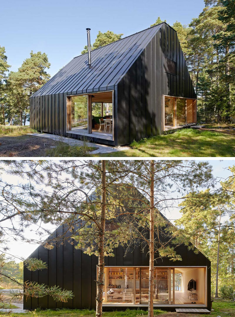 19 Examples Of Modern Scandinavian House Designs | The black siding seamlessly connects with the black roof to create a striking look against the green forest surrounding it.