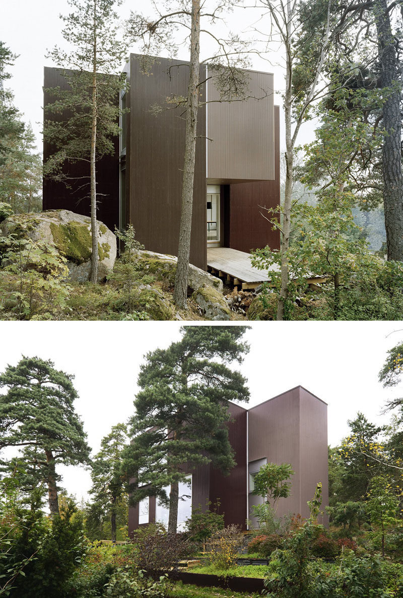 19 Examples Of Modern Scandinavian House Designs | The dark wood siding covering this secluded home helps it blend into the forest surrounding it and gives it a more natural feel.