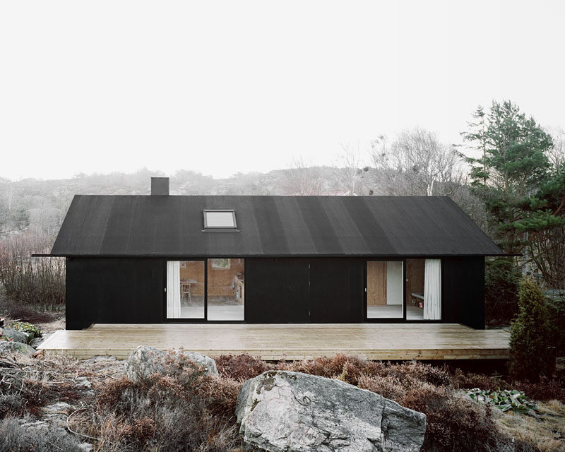19 Examples Of Modern Scandinavian House Designs | The all black exterior of this simple home gives it a modern look and helps it stand out from its surroundings.