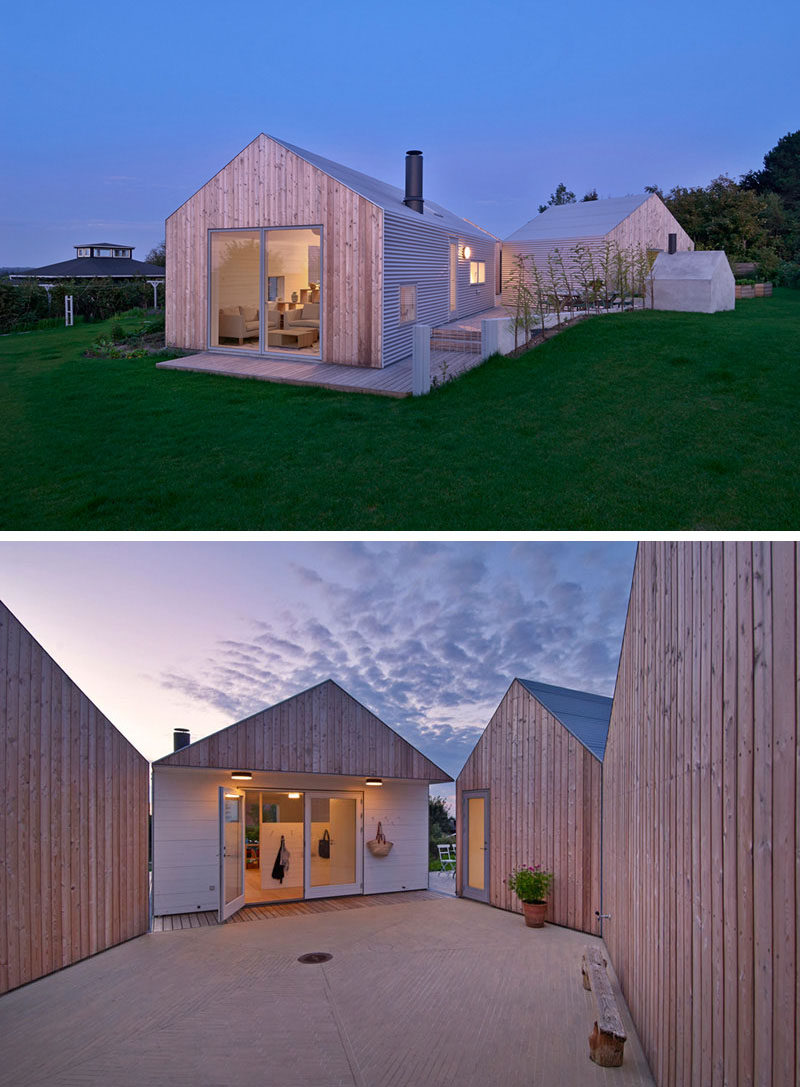 19 Examples Of Modern Scandinavian House Designs | The five separate buildings that make up this home all feature both light wood and metal siding as well as metal roofs that allow the home to look unified despite its divided layout.